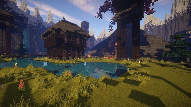 Zu sehen ist einen Screenshot aus dem Spiel Minecraft. Ein Haus steht an einem See. Umgeben ist die Szenerie von mächtigen Bergen.